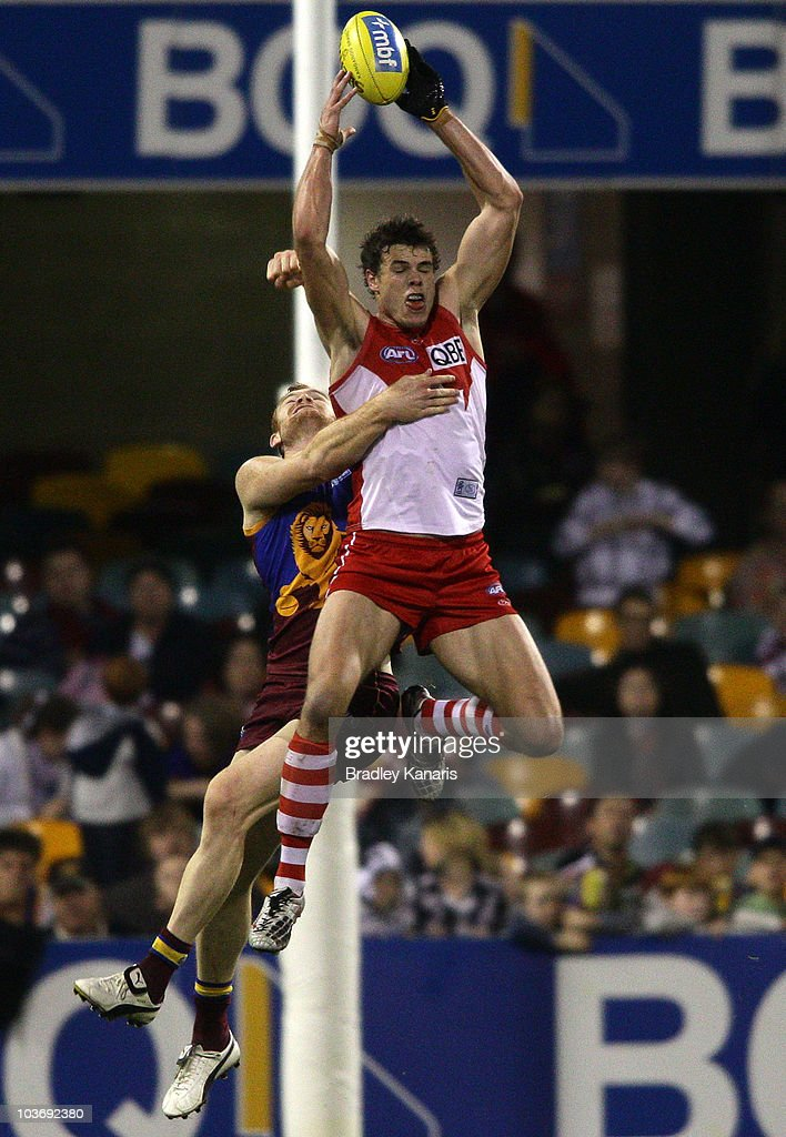 Mike Pyke of the Swans takes a mark during the round 22 AFL match between the Brisbane Lions and the Sydney Swans at The Gabba on August 28, 2010 in Brisbane, Australia.
