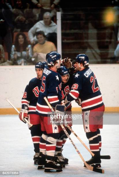 Mike Ramsey Bill Baker and Dave Christian of The United States hockey team celebrates after scoring a goal during a game at the Winter Olympics circa...