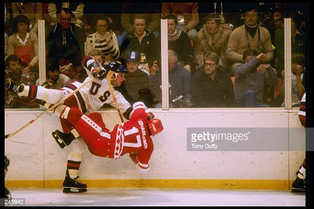 Mike Ramsey of the United States checks Valeri Kharlamov of the Soviet Union during the Winter Olympic Games on February 22 1980 in Lake Placid New...