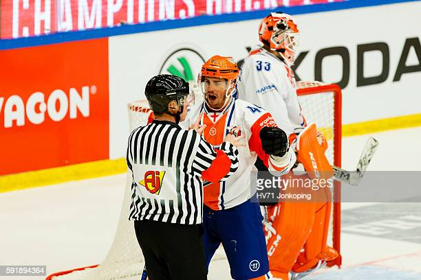 Mike Ratchuk of Sheffield Steelers reacts towards referee Petri Lindqvist during the Champions Hockey League match between HV71 Jonkoping and...