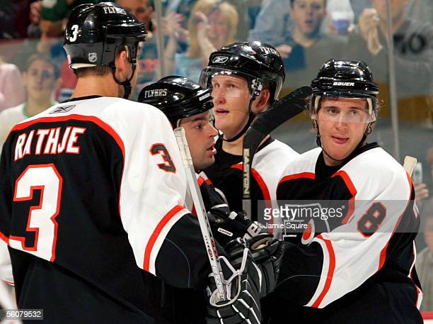 Mike Rathje Jon Sim Joni Pitkanen and Mike Richards of the Philadelphia Flyers celebrate after a goal by Sim in the third period against the...