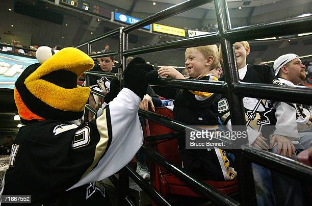Mike Recktenwald as the Pittsburgh Penguins mascot Iceburgh entertains fans during the Pittsburgh Penguins game against the New York Islanders on...