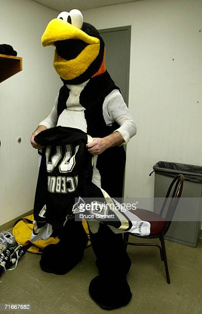 Mike Recktenwald changes into the Pittsburgh Penguins mascot Iceburgh before the Pittsburgh Penguins game against the New York Islanders on April 17...