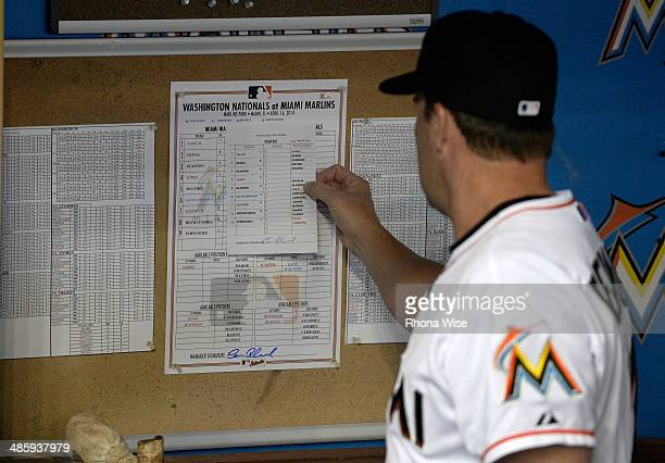 Mike Redmond manager of the Miami Marlins checks the lineup card in the dugout before the game against the Washington Nationals at Marlins Park on...