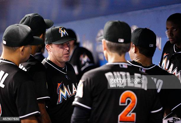 Mike Redmond of the Miami Marlins talks in the dugout before the game against the Washington Nationals at Marlins Park on July 29 2014 in Miami...