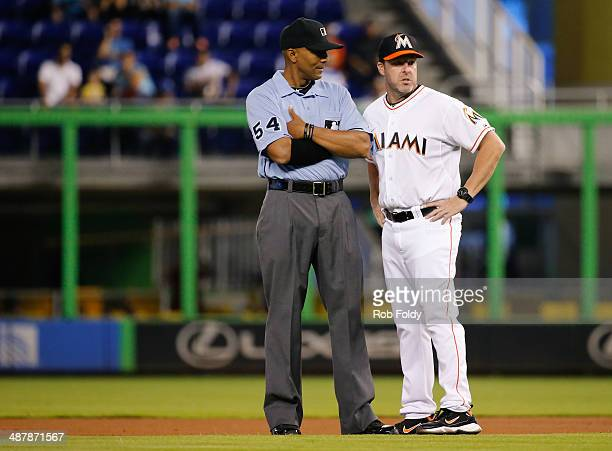 Mike Redmond of the Miami Marlins talks with umpire CB Bucknor during the first inning of the game at Marlins Park on May 02 2014 in Miami Florida