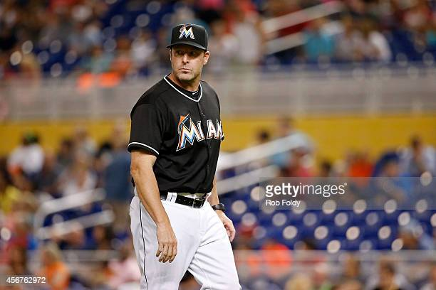 Mike Redmond of the Miami Marlins walks off the field during the game against the Philadelphia Phillies at Marlins Park on September 23 2014 in Miami...