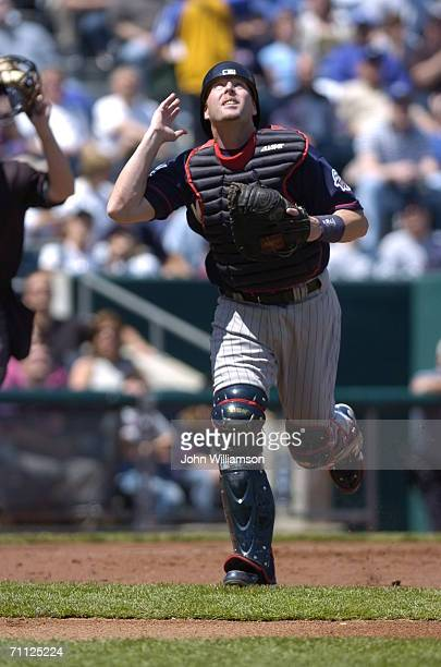 Mike Redmond of the Minnesota Twins fields a fly ball during the game against the Kansas City Royals at Kauffman Stadium in Kansas City Missouri on...