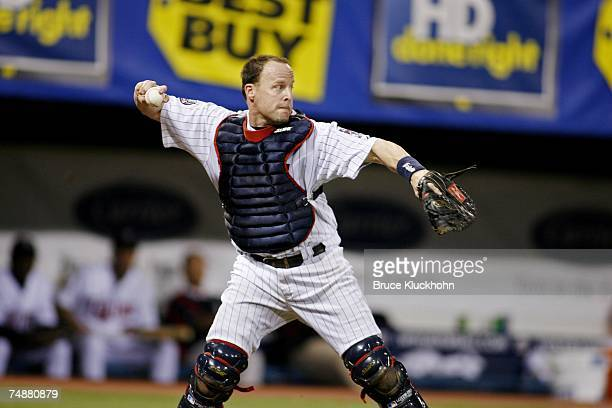 Mike Redmond of the Minnesota Twins throws the ball in a game against the Milwaukee Brewers at the Humphrey Metrodome in Minneapolis, Minnesota on...