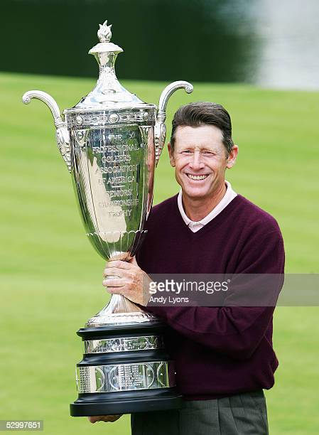 Mike Reid holds the winner's trophy after winning the Senior PGA Championship on May 29 2005 at Laurel Valley Golf Club in Ligonier Pennsylvania He...