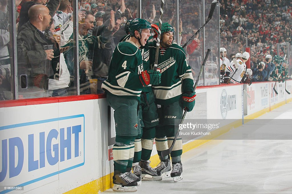 Mike Reilly #4, Jarret Stoll #19, and Matt Dumba #24 of the Minnesota Wild celebrate after scoring a goal against the Chicago Blackhawks during the game on March 29, 2016 at the Xcel Energy Center in St. Paul, Minnesota.