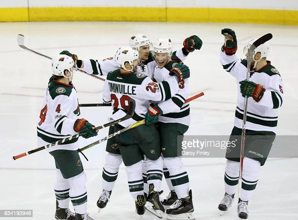 Mike Reilly Jason Pominville Nino Niederreiter Charlie Coyle and Christian Folin of the Minnesota Wild celebrate a second period goal against the...