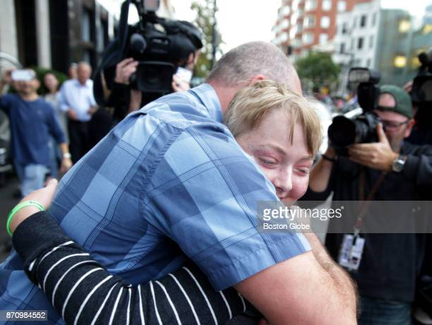 Mike Reilly of Medford left and Jack Eppley of Columbus OH right hug each other in front of the Mandarin Oriental Hotel in Boston on Nov 3 2017...