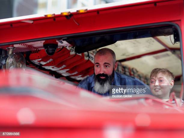 Mike Reilly of Medford left gives Jack Eppley of Columbus OH right a tour inside a Boston Duck Boat in Boston on Nov 3 2017 Eppley had just arrived...