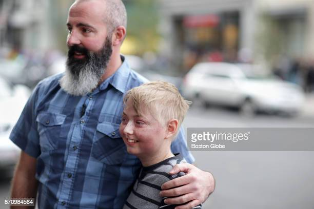 Mike Reilly of Medford left poses with Jack Eppley of Columbus OH in front of the Mandarin Oriental Hotel in Boston on Nov 3 2017 Eppley had just...
