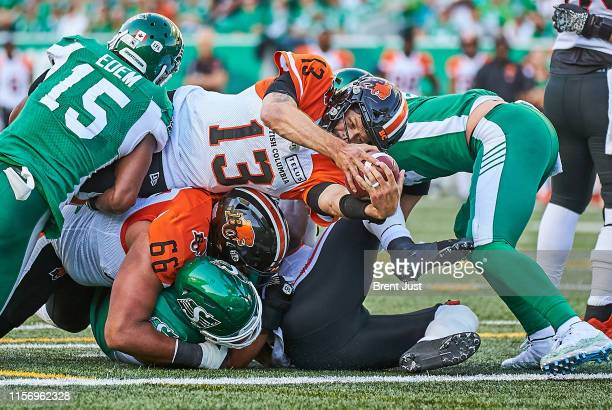 Mike Reilly of the BC Lions dives over the pile and reaches the ball over the line for a late first half touchdown in the game between the BC Lions...