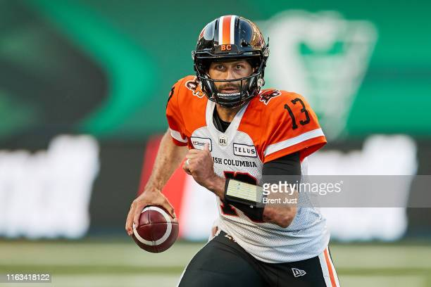 Mike Reilly of the BC Lions scrambles with the ball in the game between the BC Lions and Saskatchewan Roughriders at Mosaic Stadium on July 20 2019...
