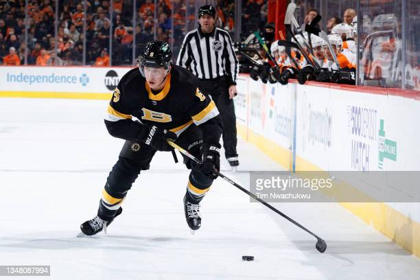 Mike Reilly of the Boston Bruins skates look to pass against the Philadelphia Flyers at Wells Fargo Center on October 20, 2021 in Philadelphia,...
