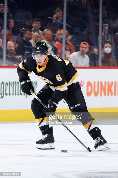 Mike Reilly of the Boston Bruins skates with the puck against the Philadelphia Flyers at Wells Fargo Center on October 20, 2021 in Philadelphia,...