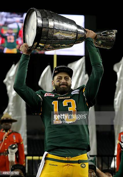 Mike Reilly of the Edmonton Eskimos holds the Grey Cup after the team defeated the Ottawa Redblacks at Investors Group Field during Grey Cup 103 on...