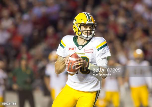 Mike Reilly of the Edmonton Eskimos looks downfield for a pass against the Ottawa Redblacks in Canadian Football League action at TD Place in Ottawa...