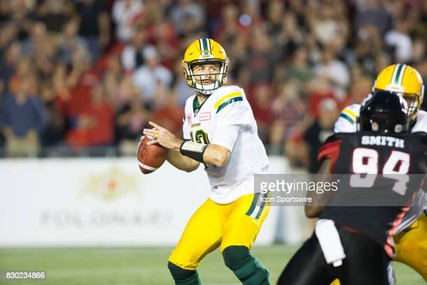 Mike Reilly of the Edmonton Eskimos looks for a receiver against the Ottawa Redblacks in Canadian Football League action at TD Place in Ottawa Canada...