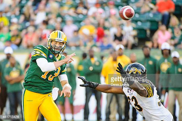 Mike Reilly of the Edmonton Eskimos makes a pass against the Hamilton TigerCats during a CFL game at Commonwealth Stadium on July 4 2014 in Edmonton...
