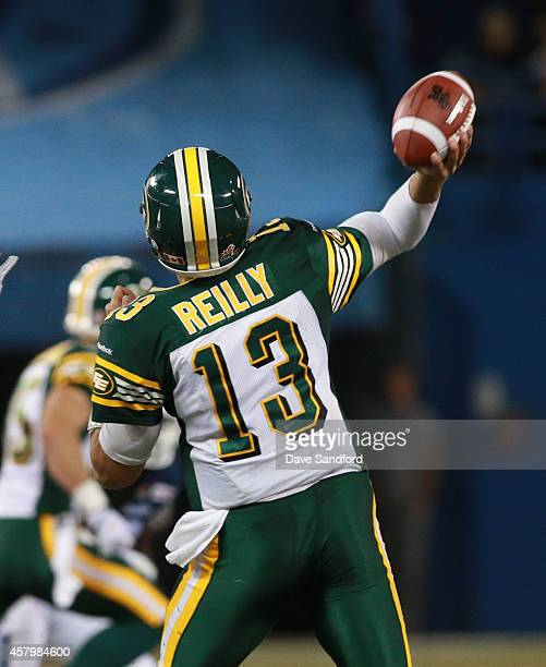 Mike Reilly of the Edmonton Eskimos makes a pass against the Toronto Argonauts during their game at Rogers Centre on October 4 2014 in Toronto...