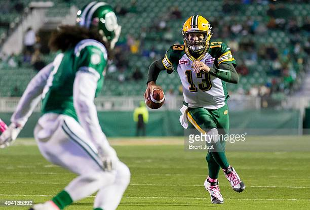 Mike Reilly of the Edmonton Eskimos scrambles for a touchdown in the game between the Edmonton Eskimos and Saskatchewan Roughriders in week 18 of the...