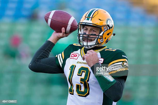 Mike Reilly of the Edmonton Eskimos throws a pass in warmup before the game between the Edmonton Eskimos and Saskatchewan Roughriders in week 18 of...