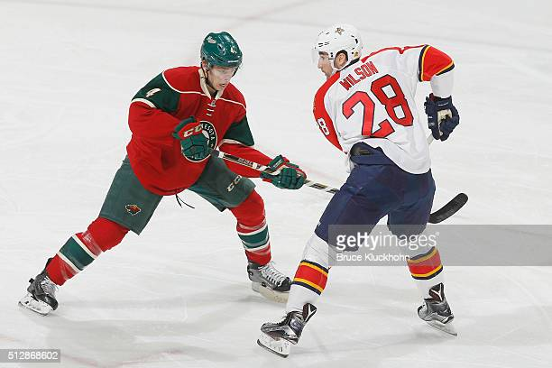 Mike Reilly of the Minnesota Wild defends Garrett Wilson of the Florida Panthers during the game on February 28 2016 at the Xcel Energy Center in St...