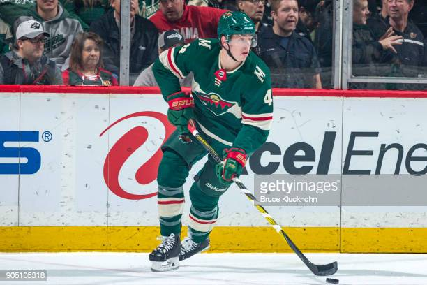 Mike Reilly of the Minnesota Wild skates with the puck against the Calgary Flames during the game at the Xcel Energy Center on January 9 2018 in St...