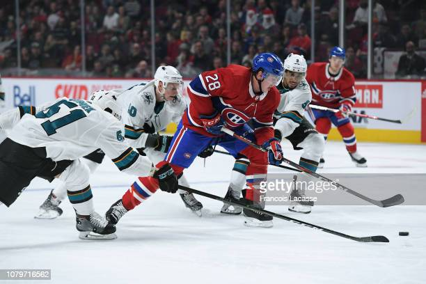 Mike Reilly of the Montreal Canadiens controls the puck while being challenged by Radim Simek Antti Suomela and Evander Kane of the San Jose Sharks...