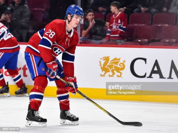 Mike Reilly of the Montreal Canadiens looks to play the puck in the warmup against the Detroit Red Wings prior to the NHL game at the Bell Centre on...