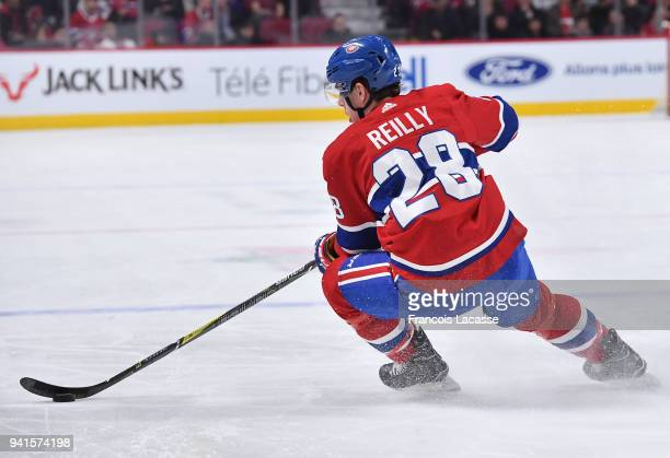 Mike Reilly of the Montreal Canadiens skates with the puck against the Detroit Red Wings in the NHL game at the Bell Centre on March 26 2018 in...