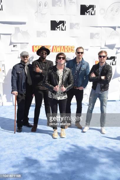 Mike Retondo , De'Mar Hamilton, Tom Higgenson, Tim Lopez, and Dave Tirio of music group Plain White T's attend The 2015 MTV Movie Awards at Nokia...