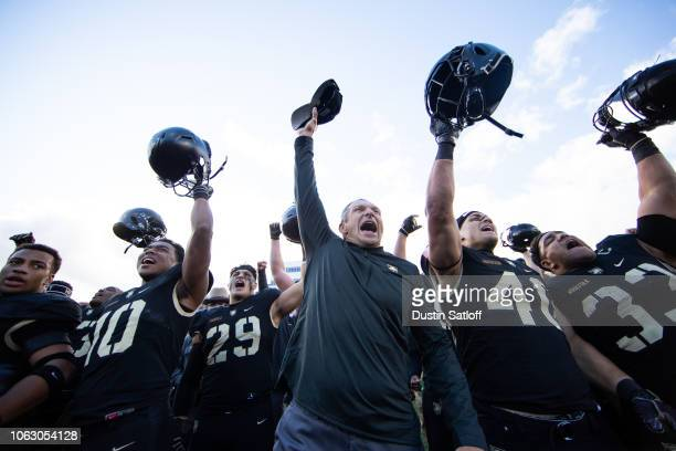 Mike Reynolds Chandler Ramirez Jeff Monken Head Coach of the Army Black Knights Andy Davidson and Darnell Woolfolk of the Army Black Knights sing the...