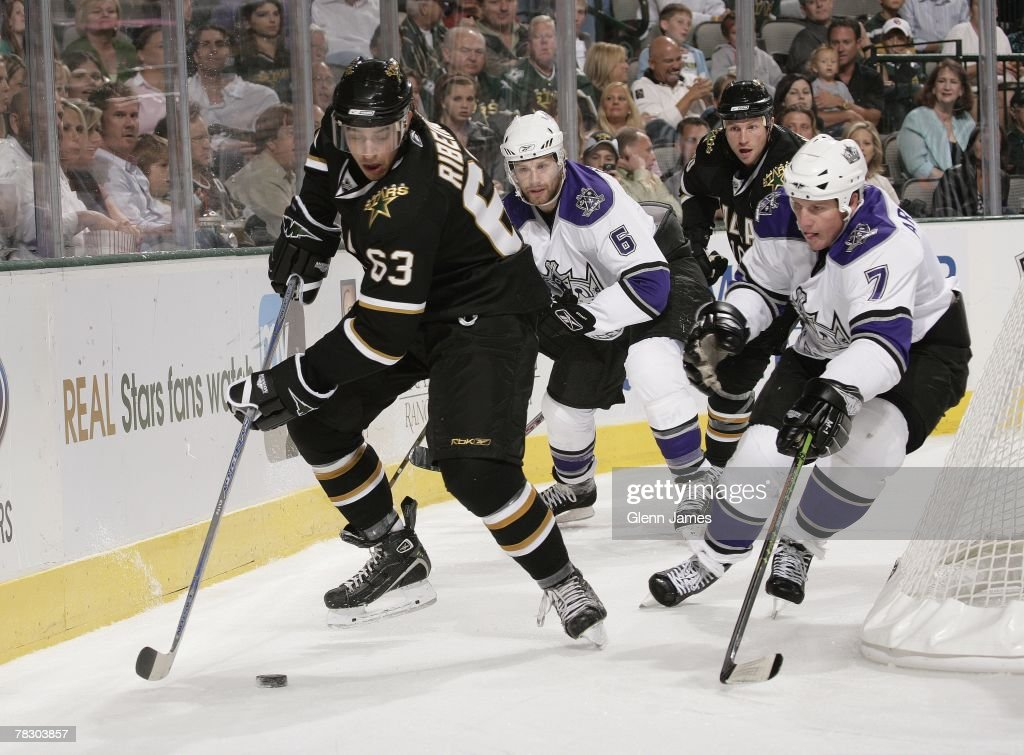 Mike Ribeiro # 63 of the Dallas Stars chases a puck around the net against Derek Armstrong #7 of the Los Angeles Kings at the American Airlines Center on October 10, 2007 in Dallas, Texas .