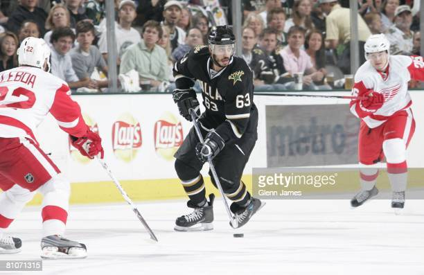 Mike Ribeiro of the Dallas Stars looks to pass to a teammate against Brett Lebda of the Detroit Red Wings during game three of the Western Conference...