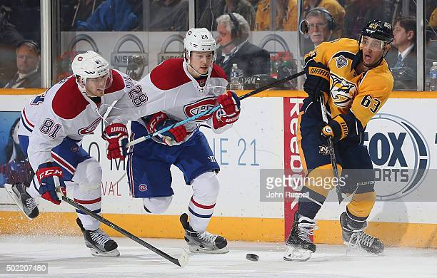 Mike Ribeiro of the Nashville Predators passes the puck against Nathan Beaulieu and Lars Eller of the Montreal Canadiens during an NHL game at...