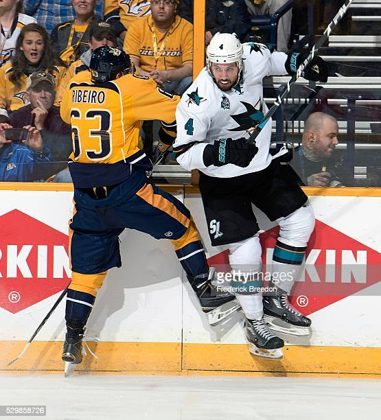 Mike Ribiero of the Nashville Predators collides with Brenden Dillon of the San Jose Sharks during the first period of Game Six of the Western...