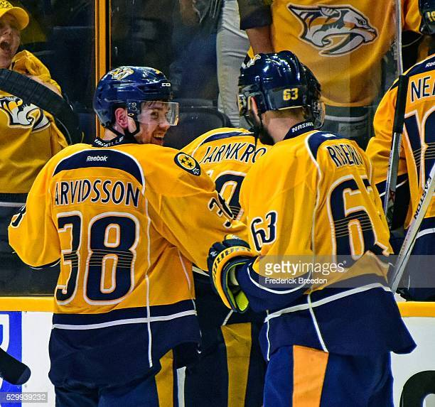 Mike Ribiero of the Nashville Predators congratulates teammate Viktor Arvidsson after scoring the game winning goal in a 43 overtime victory of Game...