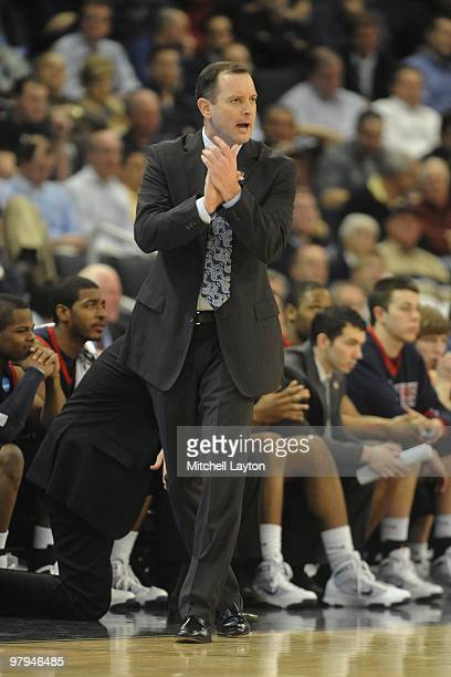 Mike Rice, head of the Robert Morris Colonials, yells to his players during the first round of NCAA Men's Basketball Championship against the...