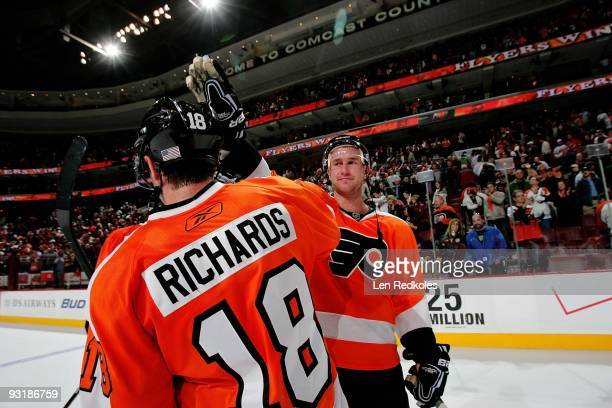 Mike Richards and Jeff Carter of the Philadelphia Flyers celebrate their 3-2 victory against the New Jersey Devils on November 16, 2009 at the...