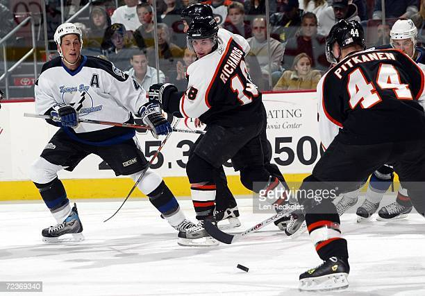 Mike Richards and Joni Pitkanen of the Philadelphia Flyers fight for the puck against Vincent Lecavalier of the Tampa Bay Lightning at the Wachovia...