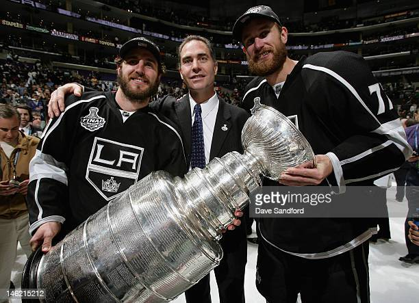 Mike Richards assistant coach John Stevens and Jeff Carter of the Los Angeles Kings pose with the Stanley Cup after the Los Angeles Kings defeated...