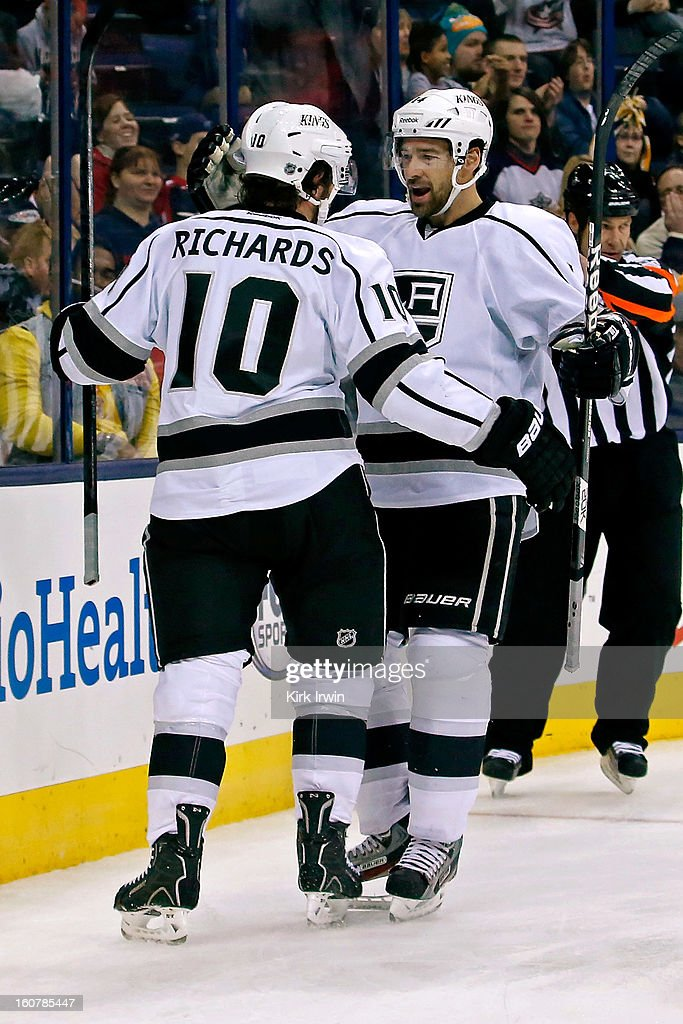 Mike Richards #10 is congratulated by Justin Williams #14 of the Los Angeles Kings after scoring a goal against the Columbus Blue Jackets during the third period on February 5, 2013 at Nationwide Arena in Columbus, Ohio. Los Angeles defeated Columbus 4-2.
