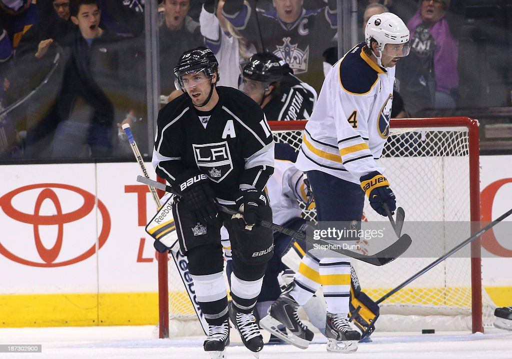 Mike Richards #10 of the Los Angeles Kings and Jamie McBain #4 of the Buffalo Sabres react after Richards scored a power play goal in the first period at Staples Center on November 7, 2013 in Los Angeles, California.