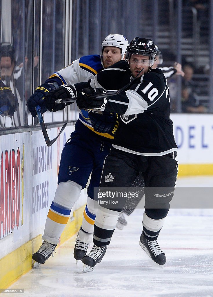 Mike Richards #10 of the Los Angeles Kings and Steve Ott #9 of the St. Louis Blues skate along the boards at Staples Center on December 18, 2014 in Los Angeles, California.