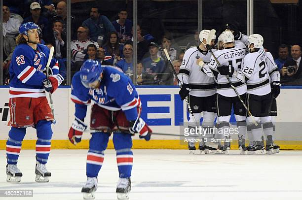 Mike Richards of the Los Angeles Kings celebrates his goal with his linemates as Carl Hagelin of the New York Rangers reacts during the second period...